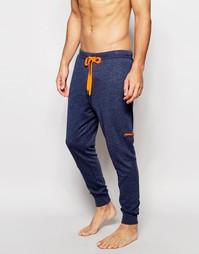 Штаны для бега слим с манжетами Calvin Klein Iron Strength - Синий