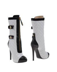 Белые Полусапоги и высокие ботинки Moschino