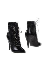 Черные Полусапоги и высокие ботинки Saint Laurent