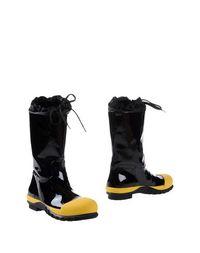 Желтые Полусапоги и высокие ботинки MIU MIU
