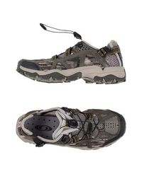 Низкие кеды и кроссовки Salomon