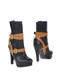 Черные Полусапоги и высокие ботинки Guess