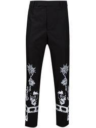 брюки с вышивками в стиле тату Alexander McQueen
