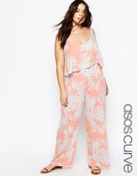 Пляжный комбинезон с цветочным принтом и рюшами ASOS CURVE - Peach