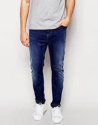 Суженные книзу джинсы с заниженным шаговым швом из эластичного денима Replay