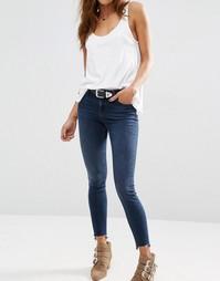 Темные джинсы скинни с классической талией и ступенчатой кромкой ASOS
