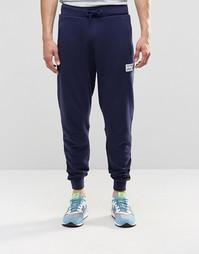 Темно-синие спортивные брюки New Balance EMP53709 - Темно-синий