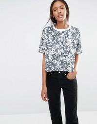 Укороченная футболка со сплошным цветочным принтом Nike - Многоцветный