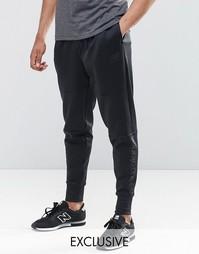 Черные зауженные спортивные брюки New Balance MP61562 - Черный