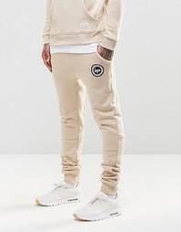 Зауженные спортивные брюки с логотипом Hype - Песок