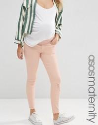 Розовые джинсы скинни с рваной отделкой ASOS Maternity Ridley