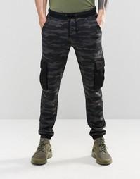 Спортивные брюки слим в стиле карго с камуфляжным принтом ASOS - Синий