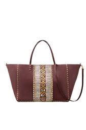Кожаная сумка с кабошонами и шипами Valentino