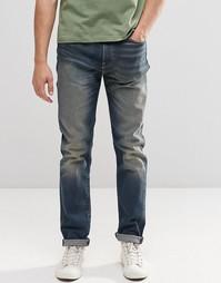 Суженные книзу джинсы слим Levi's 522 - American hero Levi's®