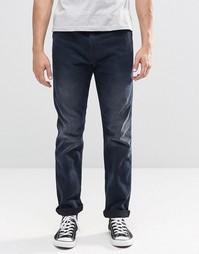 Темные суженные книзу джинсы слим Levi's Line 8 522