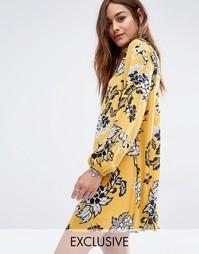Свободное платье с открытой спиной и цветочным принтом Reclaimed Vinta