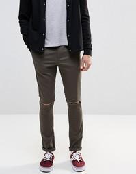 Хлопковые суперзауженные брюки хаки с рваной отделкой ASOS