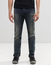 Темные винтажные джинсы слим с потертостями Diesel Belther 854S