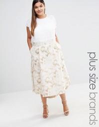 Золотистая жаккардовая юбка с цветочным принтом и асимметричным подоло Elvi