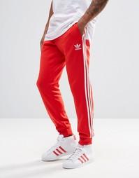 Спортивные штаны с манжетами adidas Originals AY7703 - Красный