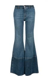 Расклешенные джинсы с контрастными брючинами и карманами Alexander McQueen