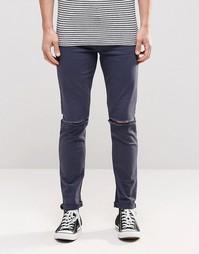 Темно-синие супероблегающие джинсы с рваными коленями ASOS