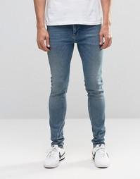 Синие зауженные джинсы в винтажном стиле ASOS - Умеренный синий