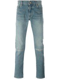 джинсы с поношенным эффектом  Saint Laurent