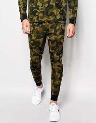 Зеленые зауженные джоггеры Nike TF 823499-347 - Зеленый