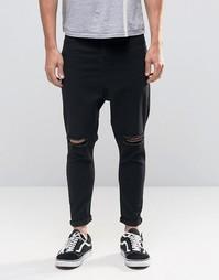 Черные рваные джинсы с заниженным шаговым швом ASOS Spray On - Черный