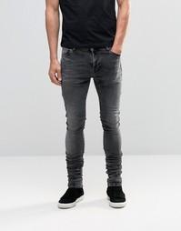 Черные мраморные удлиненные джинсы скинни со сборками ASOS