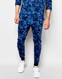 Зауженные синие джоггеры Nike TF 823499‑480 - Синий