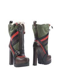 Коричневые Полусапоги и высокие ботинки Dsquared2