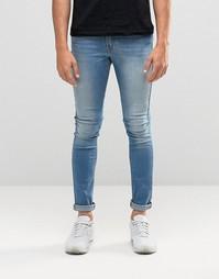 Светлые супероблегающие джинсы ASOS - Светло-голубой