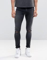 Черные выбеленные супероблегающие джинсы с рваными коленями ASOS