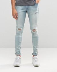 Супероблегающие джинсы с дырками на коленях ASOS - Выбеленный синий