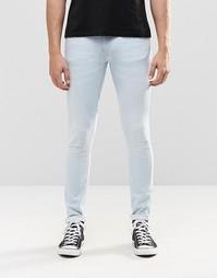 Светло-голубые супероблегающие джинсы с выбеленным эффектом Nudie