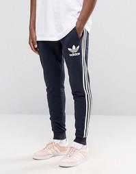 Джоггеры с логотипом-трилистником adidas Originals AY7783 - Синий