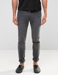 Супероблегающие джинсы с рваной отделкой и текстовым принтом ASOS