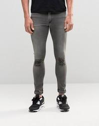 Серые супероблегающие джинсы с рваными коленками ASOS - Серый