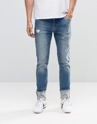 Зауженные джинсы с отворотами и прорехами ASOS - Умеренный синий