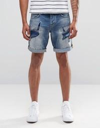 Джинсовые шорты с заштопанными дырками Celio - Стираный деним