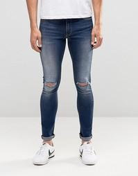Супероблегающие джинсы с дырками на коленях ASOS - Умеренный синий