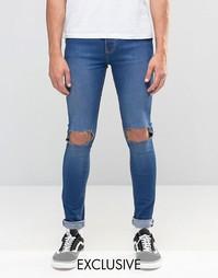 Супероблегающие выбеленные рваные джинсы Reclaimed Vintage - Синий