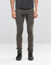 Супероблегающие джинсы цвета хаки с камуфляжными отворотами ASOS - Зеленый
