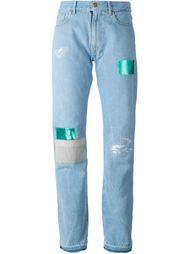 джинсы с заплатками Aries