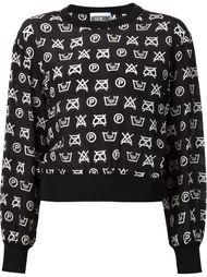 топ с символами по уходу за одеждой Moschino