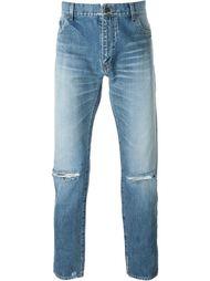 джинсы с прорезями на коленях Saint Laurent
