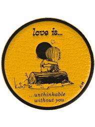 стикер 'Love Is'  Anya Hindmarch