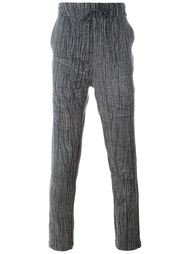 спортивные брюки с эффектом змеиной кожи Tony Cohen